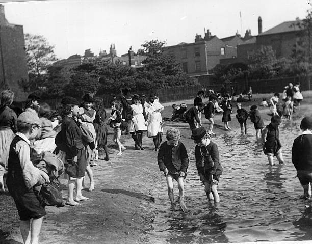 Children paddling in the grounds of Lambeth Palace...