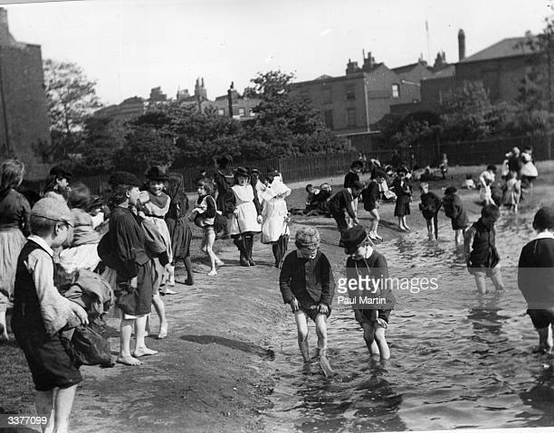 Children paddling in the grounds of Lambeth Palace during summer