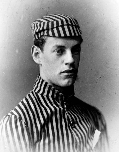 English novelist John Galsworthy wearing a striped...