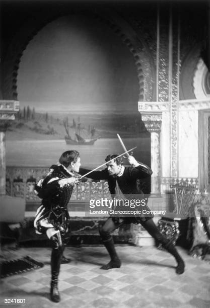 English stage actor John Martin Harvey fencing with another man in Shakespearian costume
