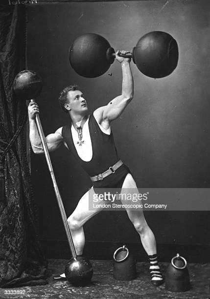German strongman Eugene Sandow lifting weights and dumbbells