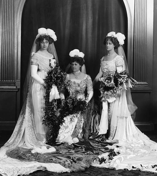 Mrs Latham poses with two bridesmaids on her wedding...