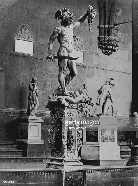 Perseus, the son of Zeus and Danae from Greek mythology, holding the severed head of the Gorgon Medusa. Sculpture by Benvenuto Cellini, in the Loggia...