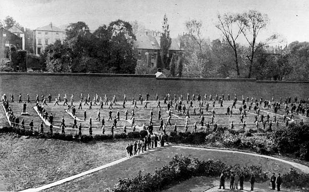 Prisoners walking around the exercise yard of Holloway...