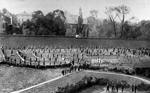 Prisoners walking around the exercise yard of Holloway Prison London