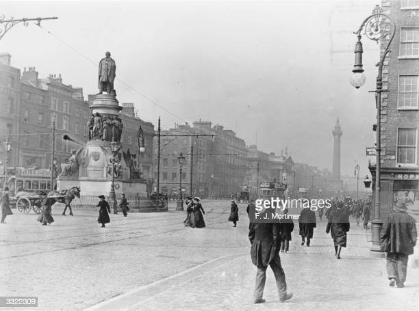 The O'Connell Monument in O'Connell Street, Dublin, with Nelson Pillar in the background.