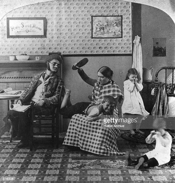 A little boy is spanked by his mother with a shoe