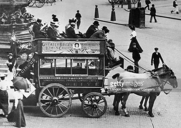 A horse drawn omnibus in London's Piccadilly Circus with an advertisement for the Exhibition of Greater Britain at Earls Court