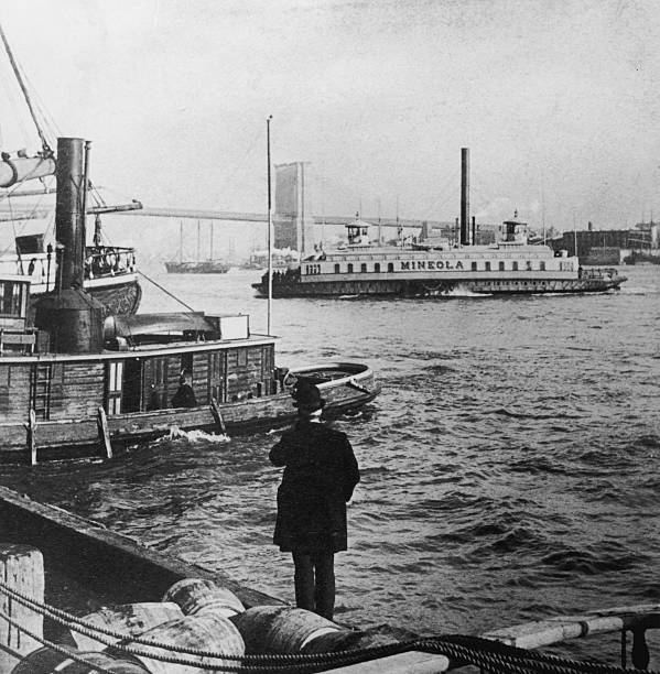 A merchant stands on the dock of New York Harbor, New...