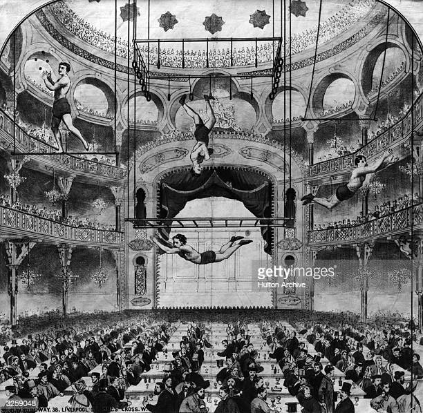 Acrobats performing for a music hall audience.