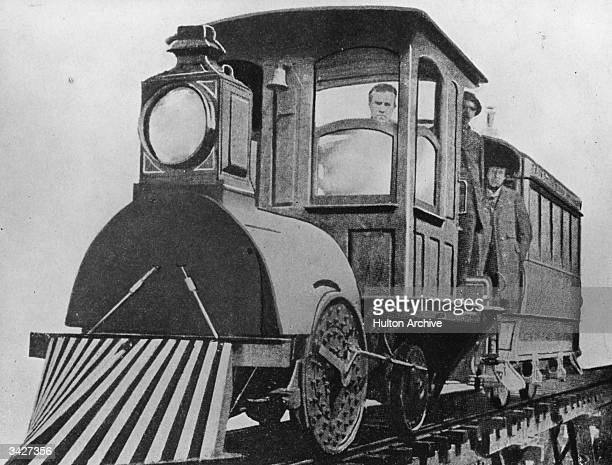 American inventor Thomas Edison driving his first electric locomotive