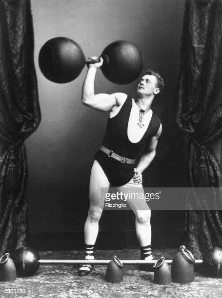 German strongman Eugene Sandow lifting weights and dumbbells
