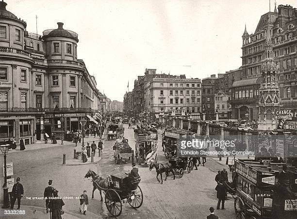 Horsedrawn traffic in the Strand London at Charing Cross station