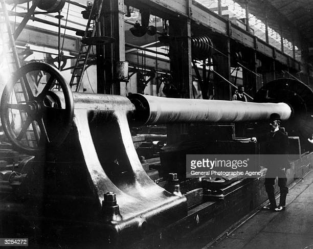 The rough turning of a large gun at Woolwich Arsenal