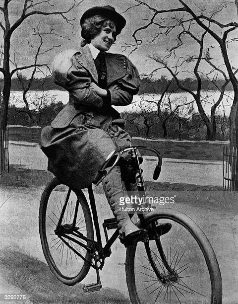 Woman sits on a 'scorcher', a Victorian bicycle, in St James' Park