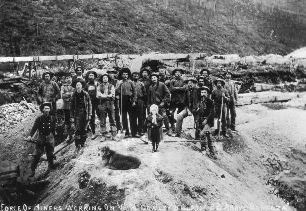 Portrait of gold miners working on W.M. Cowley's claim,...