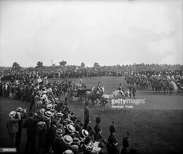 Queen Victoria arriving at the Aldershot Review in Surrey on a horse drawn carriage