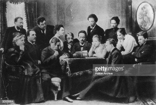 Anton Chekhov reading his play 'The Seagull' to members of the Moscow Arts Theatre including theatre director and actor Stanislavsky who is sitting...