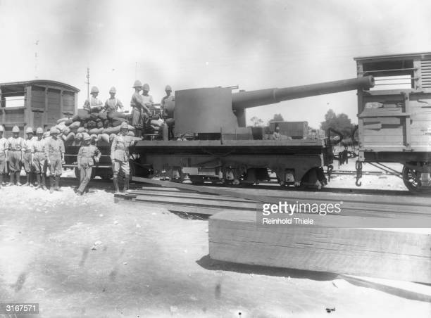 A British sixinch naval gun mounted on a railway truck ready to be sent forward to the Modder River Station Original Publication The Graphic pub 17th...