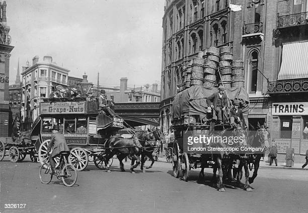 A Covent Garden horsedrawn cart piled high with baskets in a street near Blackfriars London
