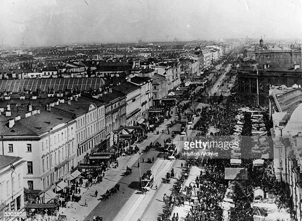Crowded Nevsky Prospect in St Petersburg, formerly Petrograd and Leningrad .