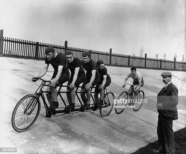 A fourman tandem team in training with the 'chase and pacemaker' whilst being timed on the stopwatch
