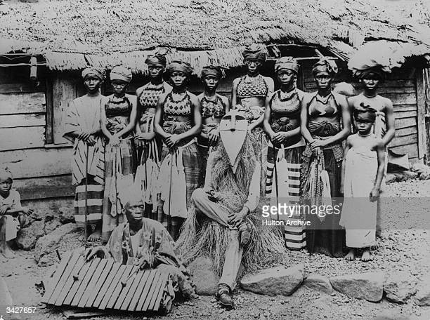 Group of Bondoo women and a witch doctor in Freetown, Sierra Leone.