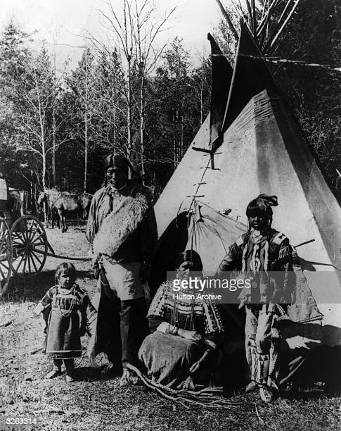 A group of Iroquois Indians outside their tepee