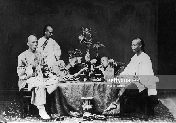 A group of opium smokers in Hong Kong
