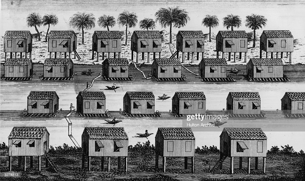 A town on a river in Borneo with houses built on stilts