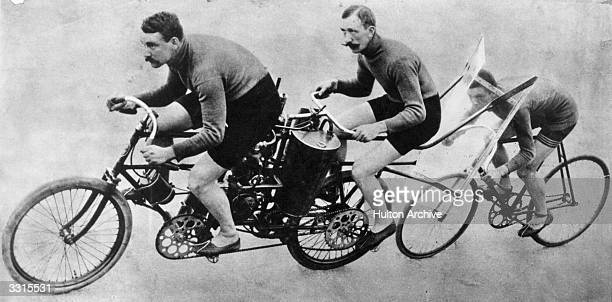 Alfred Koescher of Berlin cycling behind a windshield attached to the back of a pacemaking motorcycle on a marathon race in Friedenau