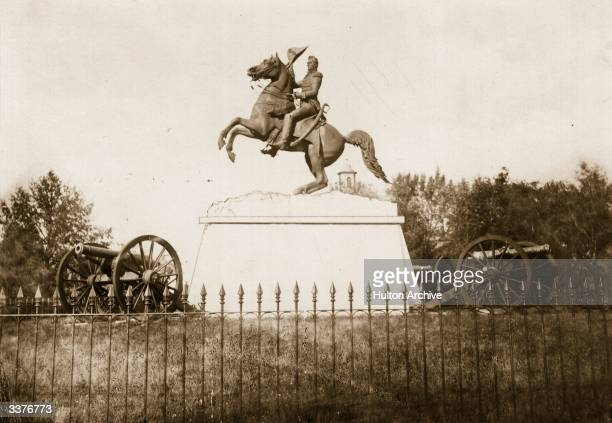 An equestrian statue by sculptor Clark Mills of General Andrew Jackson the 7th President of the United States flanked by cannons and surrounded by...