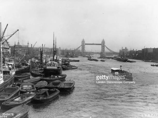 Boats in the pool of London with Tower bridge in the background