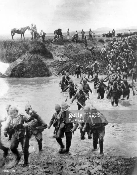 British soldiers crossing a river during the Boer War