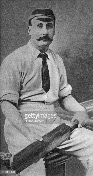 Cambridge University player and captain of Yorkshire County Cricket team, Lord Hawke in cricketing gear and holding a cricket bat. He became...
