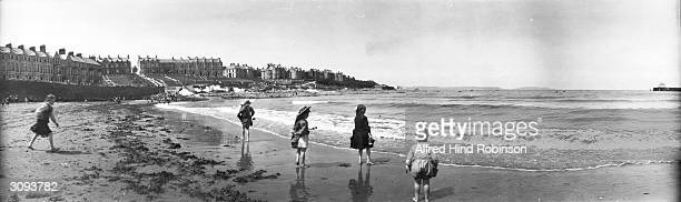 Children paddling at the beach in Bangor County Down Ulster's largest seaside resort