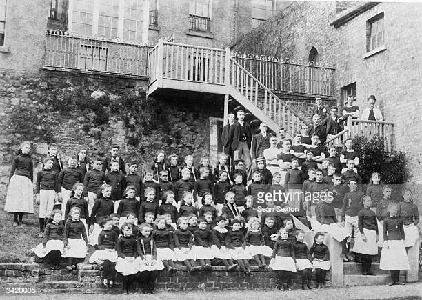 Children standing outside the Convent of Mercy Orphanage in Seatown Place Dundalk County Louth They are posing at the back of StJosephs Industrial...