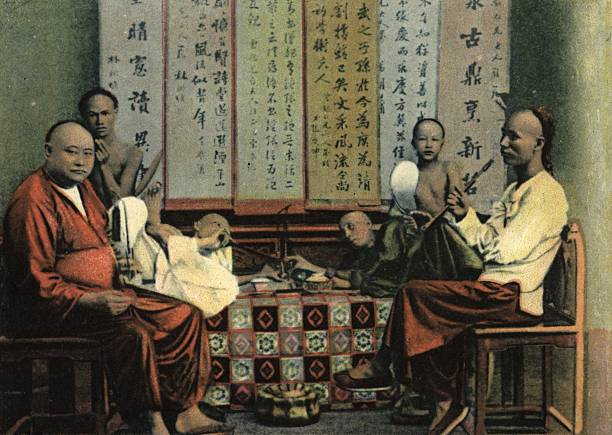 Chinese opium smokers with hookah pipes in Hong Kong....