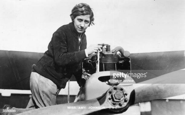 English aviatrix Amy Johnson at work on an aeroplane