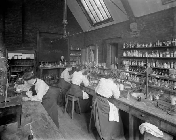 Female undergraduates at work in the laboratory at...