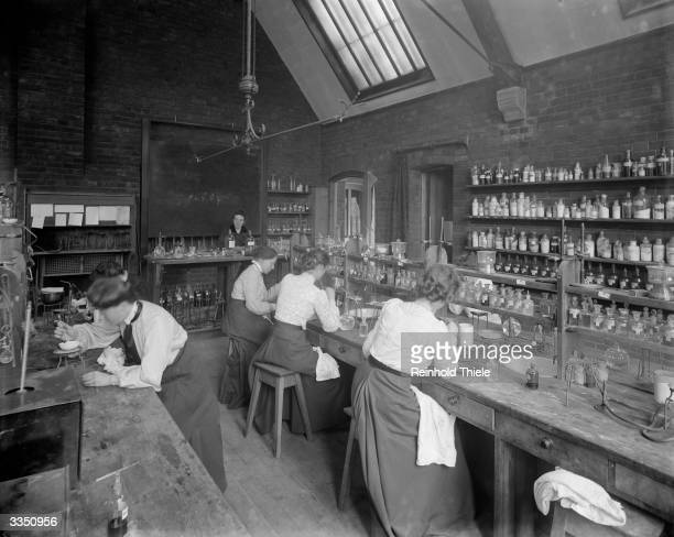 Female undergraduates at work in the laboratory at Girton College Cambridge University The college founded in 1869 was the first for female...