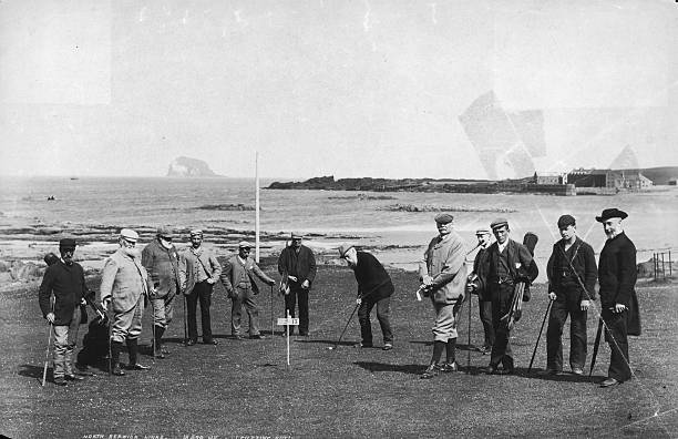 Golfers putting out on the links at North Berwick,...