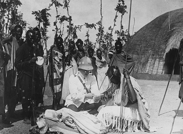 Interaction between a European colonizer and a tribal...