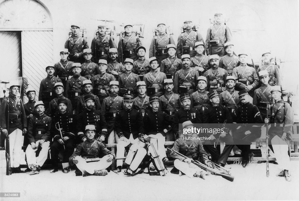Members of the 1st Regiment of the French Foreign Legion pose at the barracks for a group photograph.