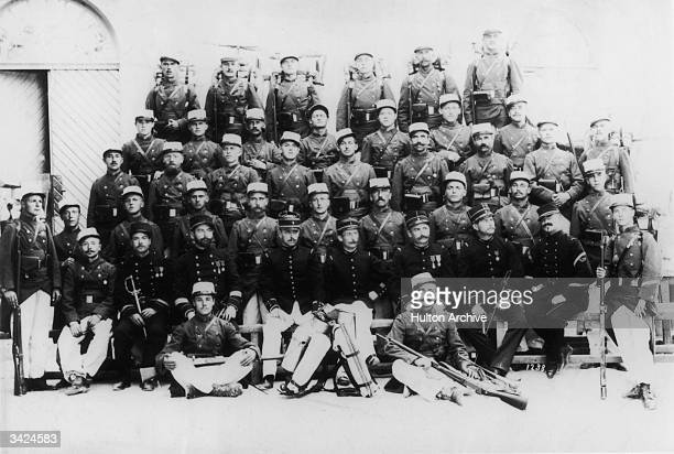 Members of the 1st Regiment of the French Foreign Legion pose at the barracks for a group photograph