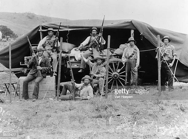 Men fighting in the Boer war relaxing outside their tent and displaying their firearms at Ladysmith in Natal