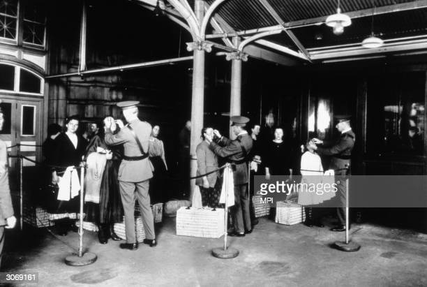 New immigrants being inspected at Ellis Island, New York, for signs of disease as they arrive in the United States.