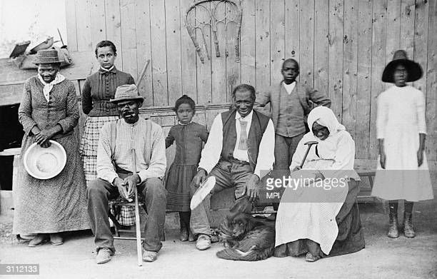 On the far left abolitionist leader Harriet Tubman ex slave and founder of the 'Underground Railroad' which provided safe houses for escaping slaves
