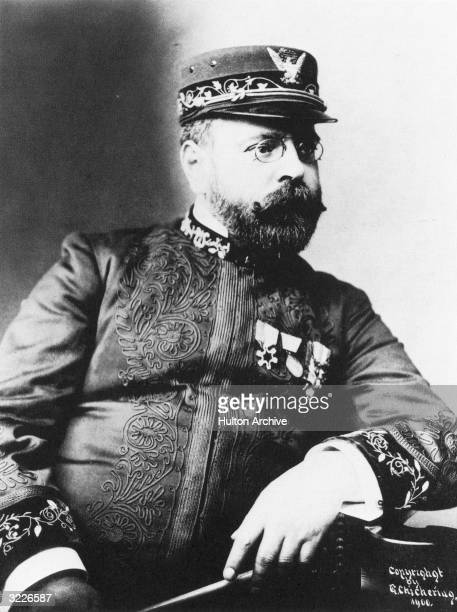 Portrait of American band master and composer of popular marches at the turn of the century John Philip Sousa wearing his band uniform and holding a...