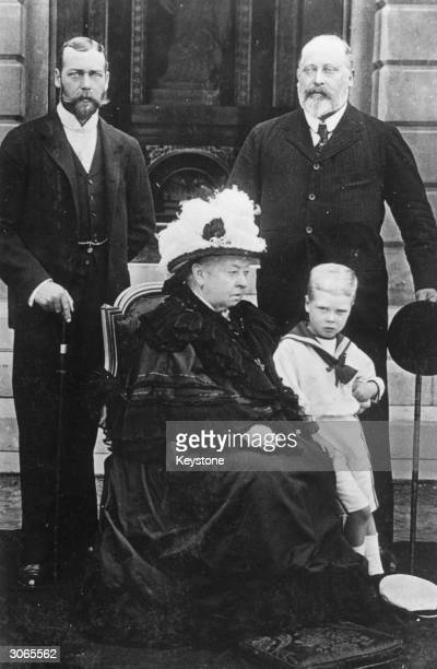 Queen Victoria with her eldest son Prince Edward Duke of Windsor later King Edward VII and his son Prince George Duke of York later King George V The...
